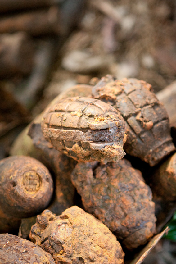 A collection of grenades left over from the battle of Eora Creek on the Kokoda Track, Papua New Guinea.