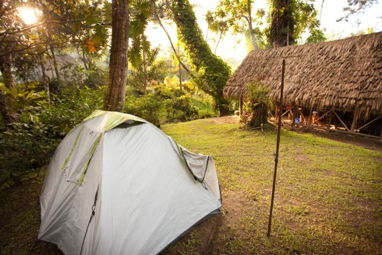 Trekkers Tents and village huts at Hoi Village, Kokoda Track.