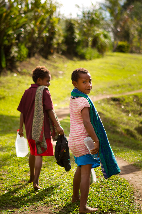 Children returning from a swim in the local creek near Efogi Village, Kokoda Track.